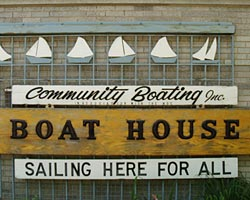Sign saying: Community Boating Inc. Boat House, Sailing Here for All.